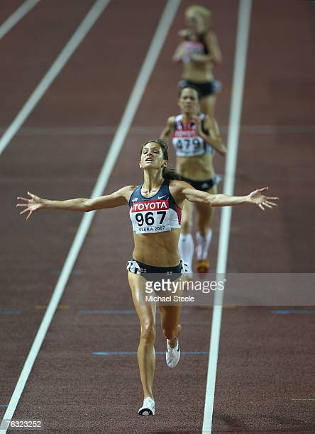 Kara Goucher of the United States of America celebrates as she crosses the line to take third place during the Women's 10000m final on day one of the...