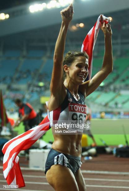 Kara Goucher of the United States of America celebrates her third place during the Women's 10000m final on day one of the 11th IAAF World Athletics...