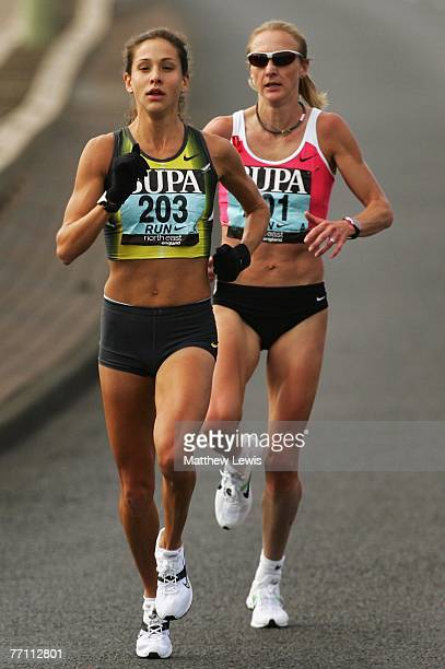 Kara Goucher of the United States pulls away from Paula Radcliffe of Great Britain during the Great North Run on September 30 2007 in...