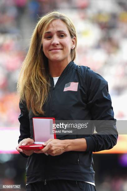 Kara Goucher of The United States recieves her reallocated silver medal from the 10000m Women race at the Osaka 2007 championships during day two of...