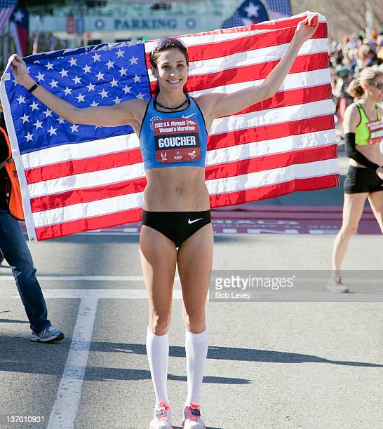 Kara Goucher poses with the American flag after qualifying in the US Marathon Olympic Trials on January 14 2012 in Houston Texas