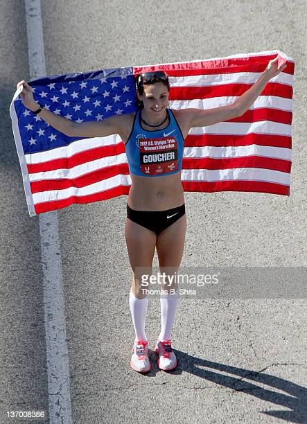 Kara Goucher who finished with a time of 22606 holds an American flag after the US Marathon Olympic Trials January 14 2012 in Houston Texas