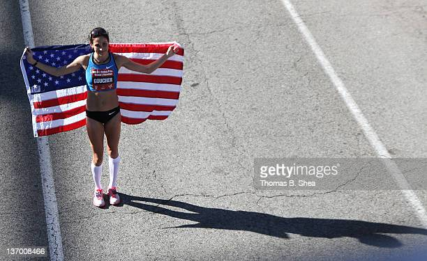 Kara Goucherm who finished with a time of 22606 holds an American flag after the US Marathon Olympic Trials January 14 2012 in Houston Texas
