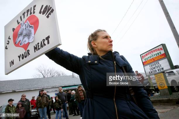 Kara K Duff of Brewster holds up a sign in protest outside Powderhorn Outfitters in Hyannis MA on Feb 10 2018 About 75 picketers lined both sides of...