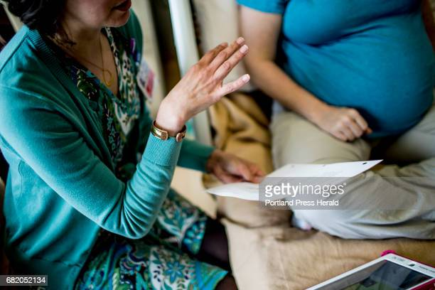 Kara Kaikini childbirth education and lactation manager at Maine Medical Center does a prenatal lactation consult with Roberta Green of Topsham...