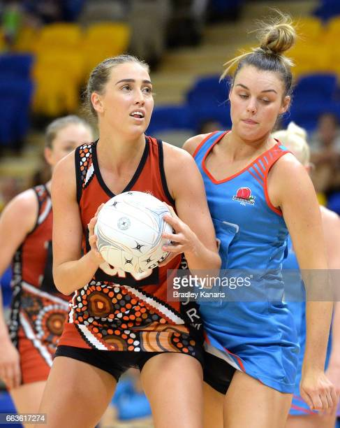 Kara Koenen of the Storm is pressured by the defence during the round seven Australian Netball League match between the Storm and the Waratahs at...