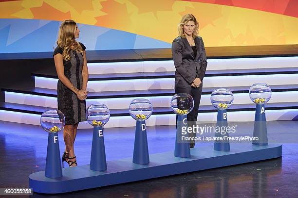 Kara Lang and Hayley Wickenheiser assist in the draws during the 2015 FIFA Women's World Cup Final Draw at the Canadian Museum of History on December...