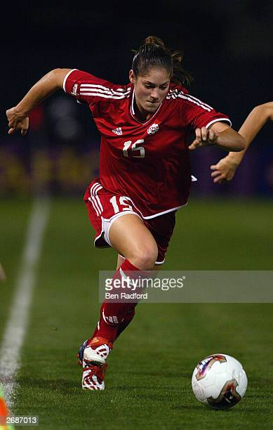 Kara Lang of Canada runs moves the ball against Sweden during the semifinals of the FIFA Women's World Cup match on October 5 2003 at PGE Park in...
