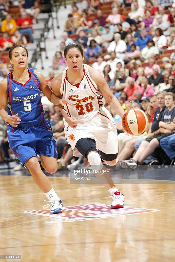 Kara Lawson #20 of the Connecticut Sun drives against Leilani Mitchell #5 of the New York Liberty during the game on June 4, 2010 at Mohegan Sun Arena in Uncasville, Connecticut.