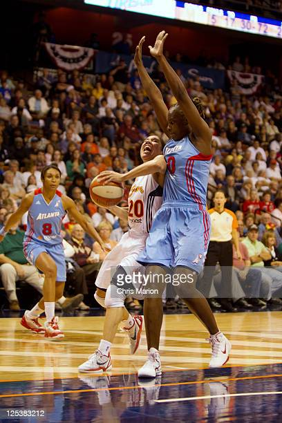 Kara Lawson of the Connecticut Sun goes hard to the basket against the Atlanta Dream in Game One of the Eastern Conference Semifinals during the 2011...
