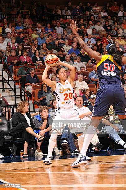Kara Lawson of the Connecticut Sun shoots the basketball against Jessica Davenport of the Indiana Fever on September 19 2012 at the Mohegan Sun Arena...