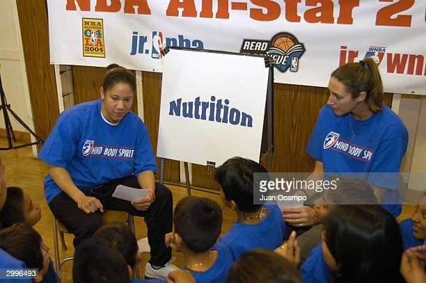 Kara Lawson of the Sacramento Monarchs and Ruth Riley of the Detroit Shock talk to children about nutrition as part of the WNBA Mind Body and Spirit...