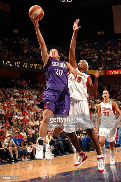 Kara Lawson of the Sacramento Monarchs drives to the basket against Asjha Jones of the Connecticut Sun during Game 2 of the WNBA Finals September 15...