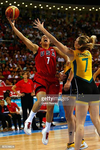 Kara Lawson of the United States goes up for a shot against Penny Taylor of Australia during the women's basketball gold medal game at the Beijing...
