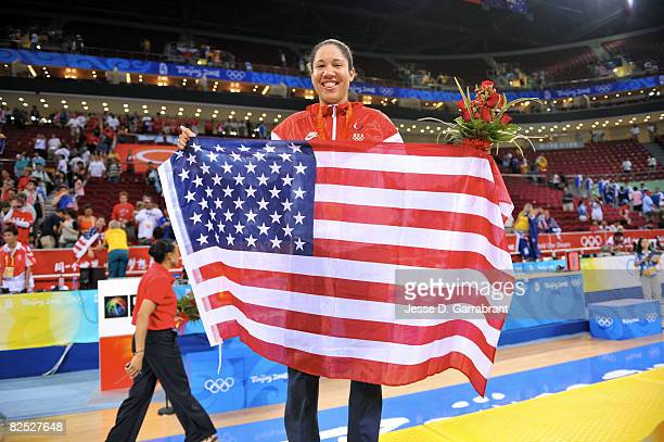 Kara Lawson of the U.S. Women's Senior National Team celebrates after winning the gold medal against Australia at the Beijing Olympic Basketball...