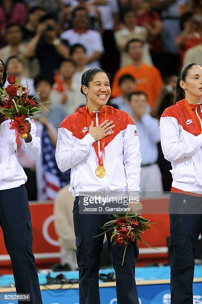 Kara Lawson of the U.S. Women's Senior National Team celebrates on the podium after winning the gold medal against Australia at the Beijing Olympic...