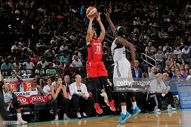 Kara Lawson of the Washington Mystics shoots the ball against the New York Liberty on June 14 2015 at Madison Square Garden in New York New York NOTE...