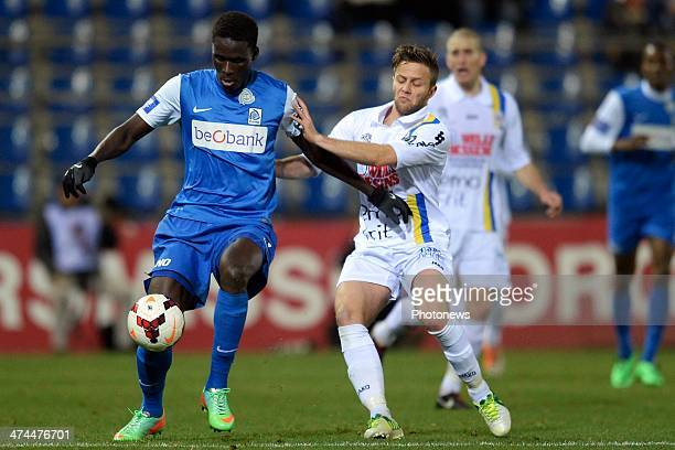 Kara Serigne Mbodji of KRC Genk battles for the ball with Robin Henkens of Waasland Beveren during the Jupiler League match between KRC Genk and...