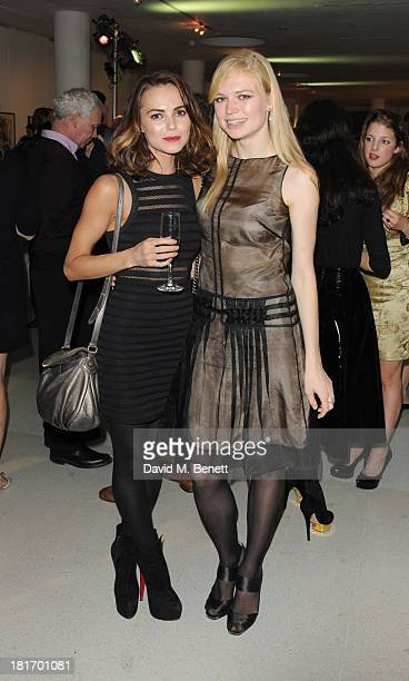 Kara Tointon and Katia Elizarova attends the Macmillan De'Longhi Art Auction at Royal College of Art on September 23 2013 in London England