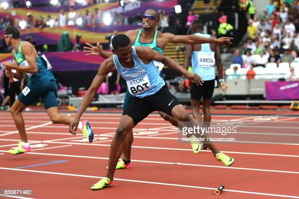 Karabo Sibanda of Botswana gets caught between Hugo De Sousa and Anderson Henriques of Brazil after dropping the baton as he competes in the Men's...