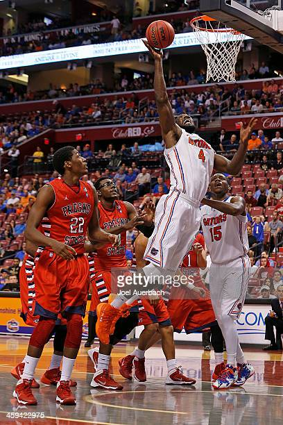 Karachi Edo and Paul Watson of the Fresno State Bulldogs watch Patric Young of the Florida Gators go to the basket during the MetroPCS Orange Bowl...