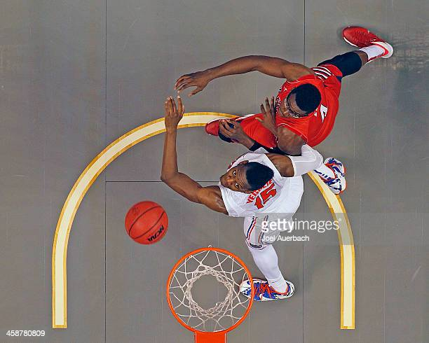 Karachi Edo of the Fresno State Bulldogs and Will Yeguete of the Florida Gators position themselves for a rebound during the MetroPCS Orange Bowl...