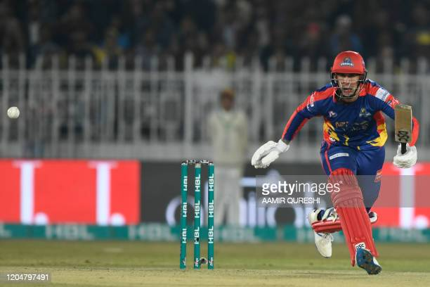 Karachi Kings' Alex Hales eyes the ball after playing a shot during the Pakistan Super League T20 cricket match between Peshawar Zalmi and Karachi...