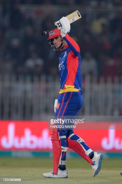 Karachi Kings Alex Hales raises his bat after his half century during the Pakistan Super League T20 cricket match between Islamabad United and...