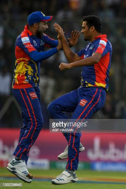 Karachi Kings' Arshad Iqbal and Mohammad Amir celebrate after the dismissal of Peshawar Zalmi's Shoaib Malik during the Pakistan Super League T20...