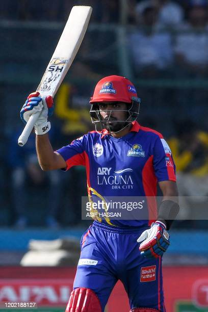 Karachi Kings' Babar Azam celebrates after scoring a half century during the Pakistan Super League Twenty20 cricket match between Peshawar Zalmi and...