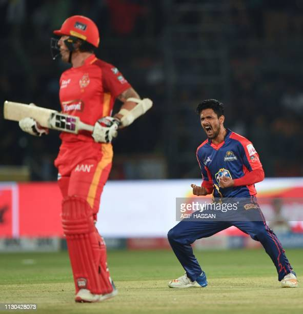 Karachi Kings cricketer Amir Yamin celebrates after taking the wicket of Islamabad United cricketer Luke Ronchi during the elimination match between...