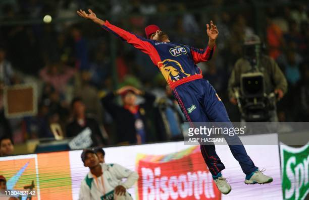 Karachi Kings cricketer Babar Azam tries to stop the ball during the elimination match between the Islamabad United and Karachi Kings of the Twenty20...