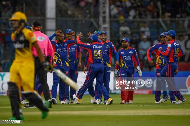 Karachi Kings' cricketers celebrate after the dismissal of Peshawar Zalmi's Haider Ali during the Pakistan Super League Twenty20 cricket match...