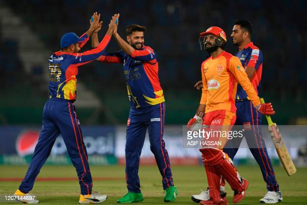 Karachi Kings Imad Wasim celebrates with teammates after dismissing Islamabad United's Shadab Khan during the T20 cricket match between Karachi Kings...