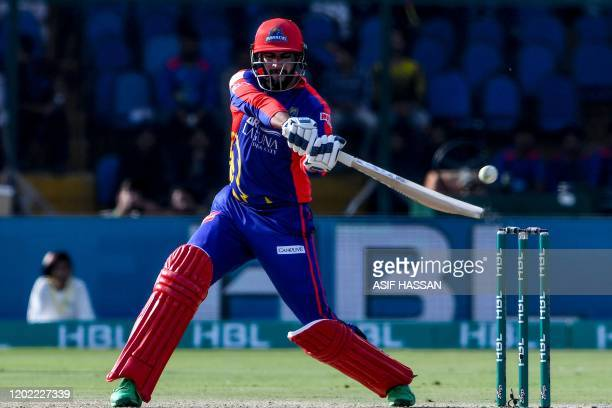 Karachi Kings' Imad Wasim plays a shot during the Pakistan Super League Twenty20 cricket match between Peshawar Zalmi and Karachi Kings at the...