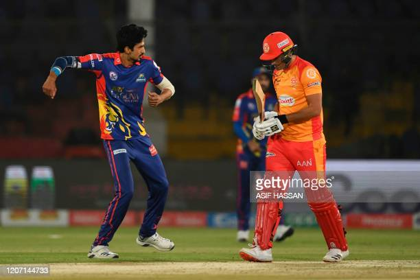 Karachi Kings Umaid Asif celebrates the wicket of Islamabad United's Rizwan Hussain during the T20 cricket match between Karachi Kings and Islamabad...