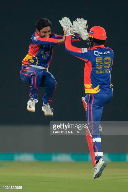 Karachi Kings Umer Khan celebrates with Chadwick Walton the wicket of Islamabad United Rizwan Hussain during the Pakistan Super League T20 cricket...