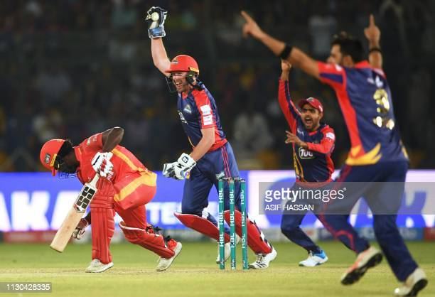 Karachi Kings wicketkeeper Ben Dunk celebrates after the dimissed of Islamabad United cricketer Chadwick Walton during the elimination match between...