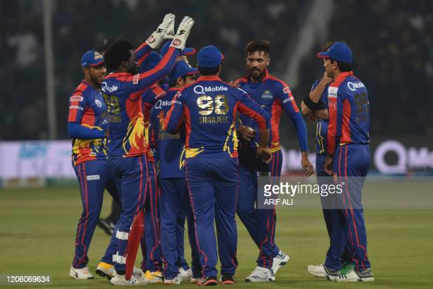 Karachi Kings's Mohammad Amir celebrates with teammates after the dismissal of Lahore Qalandars's Fakhar Zaman unseen during the T20 cricket match...