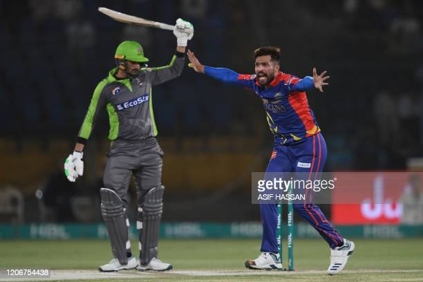 Karachi Kings's Mohammad Amir makes an appeal for caught behind the wickets against Lahore Qalandars's captain Sohail Akhtar during the T20 cricket...