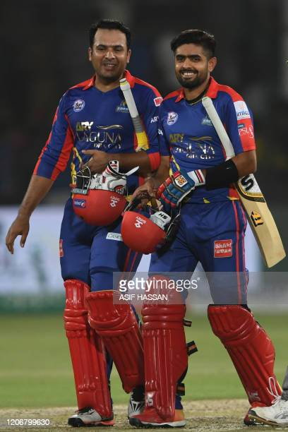 Karachi Kings's Sharjeel Khan and Babar Azam walk back to pavilion after winning the T20 cricket match between Lahore Qalandars and Karachi Kings at...