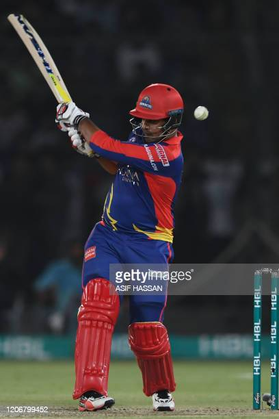 Karachi Kings's Sharjeel Khan plays a shot during the T20 cricket match between Lahore Qalandars and Karachi Kings at the National Cricket Stadium in...