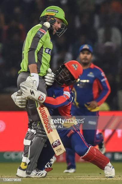 Karachi Kings's wicketkeeper Chadwick Waltaon attempts for a catch of Lahore Qalandars's Ben Dunk during the Pakistan Super League T20 cricket match...