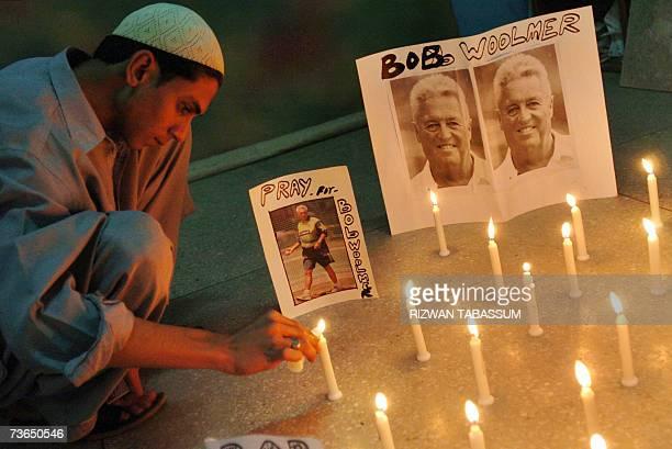 A Pakistani cricket fan lights candles to pay tribute to Pakistan cricket coach Bob Woolmer in Karachi 21 March 2007 Former Pakistani legends Imran...