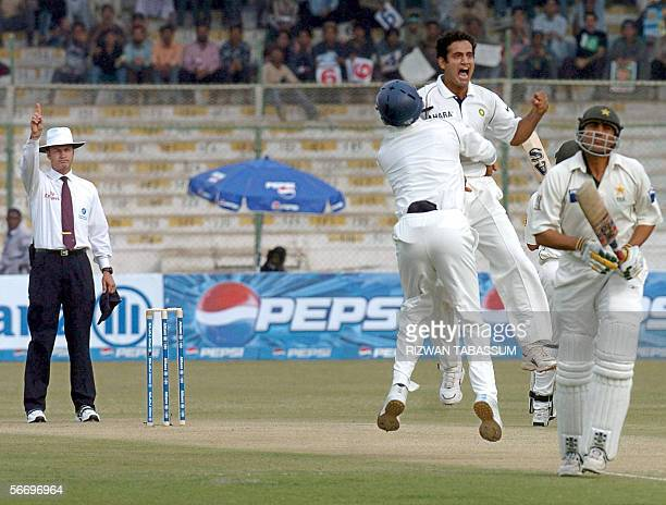 Indian bowler Irfan Pathan celebrates with teammates after the wicket of Pakistani batsman Younis Khan during the first day of the third and final...