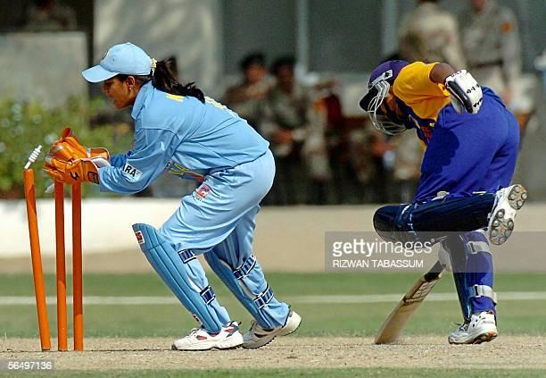 Indian female wicketkeeper Anjum Chopra attempts unsuccessfully to run out Sri Lankan batswoman Randika Galhenege during the second Asia Cup match...