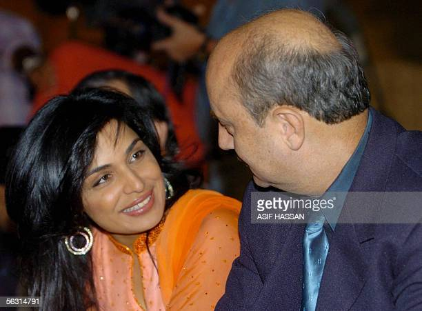Indian film actor Anupam Kher talks with Pakistani popular film actress Meera prior to the opening ceremony of 5th International Film Festival in...