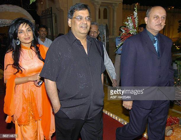 Indian film producer Subhash Ghai and actor Anupam Kher and popular Pakistani film actress Meera arrive prior to the opening ceremony of 5th...