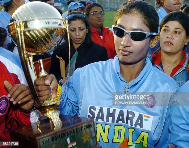 Indian women's cricket team captain Mithali Raj holds the Asia Cup trophy after India defeated Sri Lanka at the National Stadium in Karachi 04...