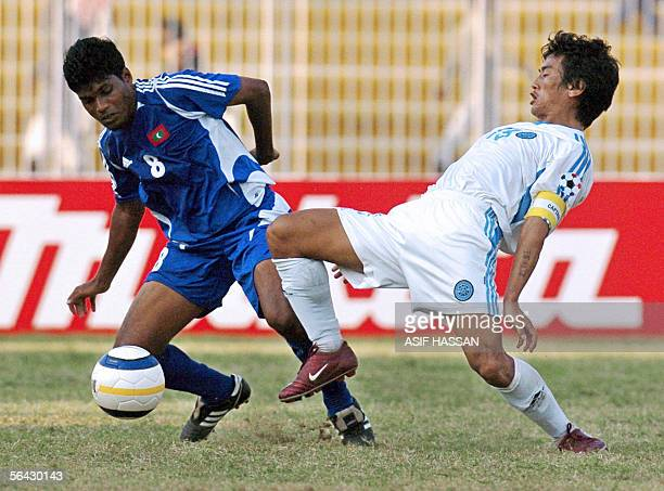 Maldives soccer player Jameel Mohamed vies with Indian player Bhaichung Bhutia during a semifinal match of the South Asian Football Federation Cup in...